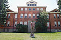 Gallatin County High School and Malcolm Story statue - Bozeman Montana - 2013-07-09 (9379474908).jpg