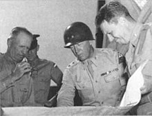 McNair confers with George Patton and others at Desert Training Center