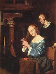 A Lady dressing her Hair