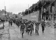 German prisoners of war escorted by American soldiers in Cherbourg in 1944.