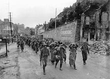 German prisoners of war escorted by American soldiers in Cherbourg in 1944.