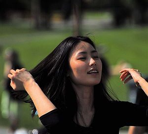 Young Asian woman moving her hair.