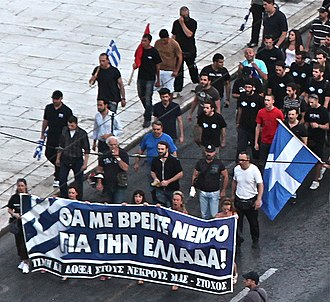 "Golden Dawn (political party) - Golden Dawn demonstration in 2012, with some of the demonstrators carrying a sign reading ""You will find me dead for Greece! – Honor and glory to our dead – 'Stochos' """