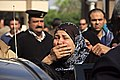 Grieving friends and relatives gather outside the Agouza Police Hosptial after a series of explosions at Cairo University left many dead or wounded - Cairo 2-Apr-2014.jpg