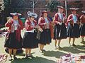 Group of women in Peru spinning with the drop spindle.jpg