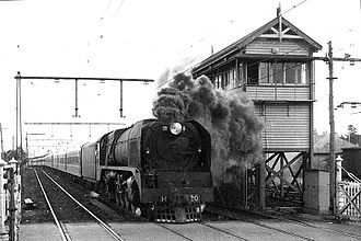 Craigieburn railway line - H 220 leads the Albury Express out of Melbourne, past the signal box at Essendon, circa 1949. (Victorian Railways photograph)