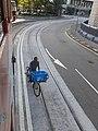 HK Central Des Voeux Road Central tram rail bike rider people at work logistics October 2020 SS2.jpg