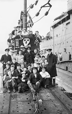 HMS Thetis (N25) - The crew of Thunderbolt and their 'Jolly Roger' flag, after a patrol in the Mediterranean