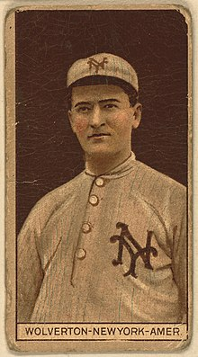 "A baseball card image of a man wearing an old-style white baseball uniform and cap with an interlocking ""NY"" on both"