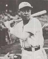 Black and white photograph showing Haruyasu Nakajima with a bat over his shoulder preparing to bat.
