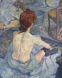 A thin woman's back and hair are prominent. She faces away from the viewer and has on only a towel and socks.
