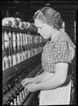 High Point, North Carolina - Textiles. Pickett Yarn Mill. Spinner - highly skilled - about 3 to 4 years to learn... - NARA - 518514.tif