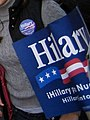 Hillary Clinton spanish-language campaign sign at senate election debate (277344907).jpg