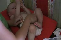 File:How to put on a prefold, a fitted, and a pocket diaper.webm