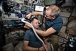 ISS-59 David Saint-Jacques trims Nick Hague's hair inside the Harmony module.jpg