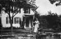 Ida Tarbell in front of the Ida Tarbell House.png