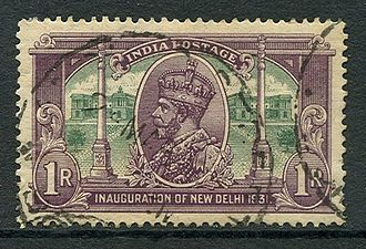 "New Delhi - The 1931 postage stamp series celebrated the inauguration of New Delhi as the seat of government. The one rupee stamp shows George V with the ""Secretariat Building"" and Dominion Columns."
