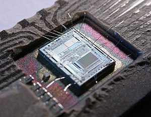 "Electronic circuit - The die from an Intel 8742, an 8-bit microcontroller that includes a CPU, 128 bytes of RAM, 2048 bytes of EPROM, and I/O ""data"" on current chip."