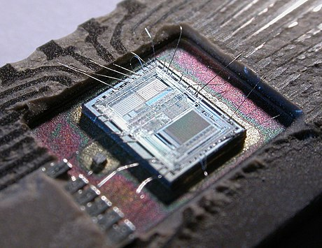 The die from an Intel 8742, an 8-bit microcontroller that includes a CPU running at 12 MHz, 128 bytes of RAM, 2048 bytes of EPROM, and I/O in the same chip 153056995 5ef8b01016 o.jpg