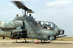 Bell AH-1 SuperCobra - U.S. Marine AH-1W SuperCobras refuel in April 2003, during the invasion of Iraq.