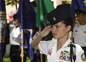 Junior Reserve Officers' Training Corps - A Navy JROTC cadet salutes during the parading of the colors ceremony held at Pearl Harbor, Hawaii.