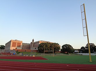 Jamaica High School - The athletic field to the rear (north) of the school