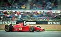 Jean Alesi - Ferrari 412T2 accelerates out of Copse at the 1995 Britsh GP, Silverstone (49716762576).jpg