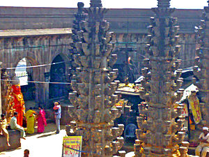 Khandoba - The Jejuri temple of Khandoba. Mani is seen worshipped as a red figure
