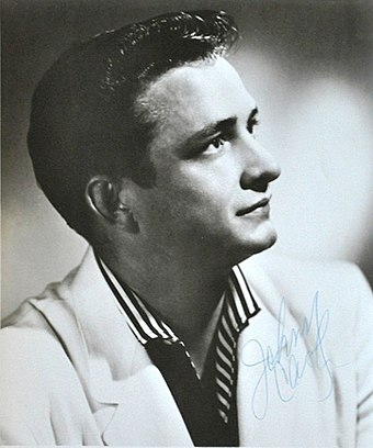 Publicity photo for Sun Records, 1955 Johnny Cash Sun Records promotional portrait (cropped).jpg
