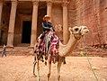 Jordan, Petra. Mirela on the camel in front of the famous monument The Treasury of Pharaoh.jpg