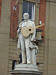 Kidderminster Town Hall - Penny Black Square, Kidderminster - Sir Rowland Hill statue - with guitar from the Kidderminster Arts Festival (29423844931).jpg