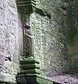 Kilbirnie Place - detail of a fireplace pillar in the keep.JPG