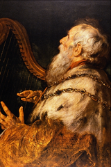 A picture of an elderly King David playing a harp