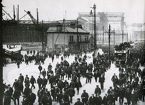 Sir William Arrol & Co. - Workers leaving the Harland & Wolff shipyard in early 1911. The RMS ''Titanic'' can be seen in the background, underneath the Arrol gantry.