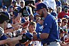 Kris Bryant signing autographs during his rehab assignment against Omaha (43598094184).jpg