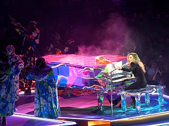 "Joanne World Tour - Gaga performing ""Come to Mama"" on the heart-shaped acrylic piano. The acoustic performances received the most praise by critics."