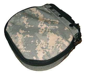 M249 light machine gun - A cloth pouch (in UCP camo) used for holding belts of linked ammunition, this one being capable of holding 200 rounds.