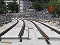 Light rail tracks on Herzl Blvd.jpg