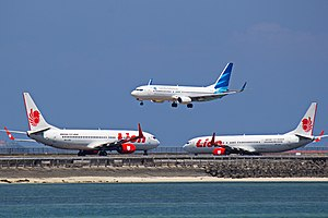 Aviation in Indonesia - Garuda Indonesia and Lion Air airplanes at Ngurah Rai International Airport, Bali in 2014