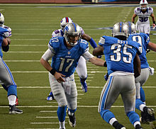 Lions backup quarterback Kellen Moore hands the ball off.jpg