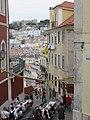Lisbon, Portugal. A narrow lane in the Chiado area with Castelo de São Jorge in the background (22921347260).jpg