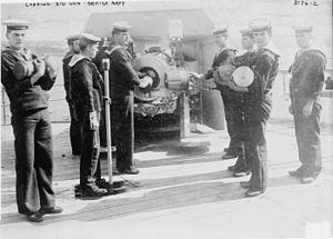QF 6 inch /40 naval gun - Loading a MK I or II deck gun on HMS ''Ariadne''. The man at left holds a shell, the men at right hold brass powder cartridges. Note the coned breech screw and lugs on the underside of the breech ring to which recoil cylinders are attached