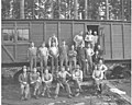 Logging crew at railroad car mess hall, with Clark Kinsey photographs piled to one side, Vance Lumber Company, Malone, ca 1916 (KINSEY 727).jpeg