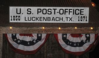 Luckenbach, Texas - Sign above the old post office