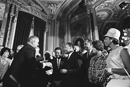 President Lyndon B. Johnson, Martin Luther King Jr., and Rosa Parks at the signing of the Voting Rights Act on August 6, 1965 Lyndon Johnson and Martin Luther King, Jr. - Voting Rights Act.jpg