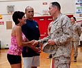 Maj. Gen. Peter Talleri recognizes two Semper Fit Center employees for rendering aid to heart attack victim 120615-M-TH981-001.jpg