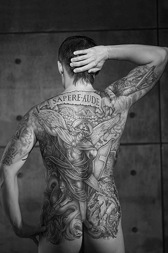 Religious perspectives on tattooing - Image: Man with a full back tattoo. Black and White image