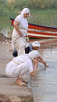 Mandaeans at prayer by the riverside, Ahvaz, Iran 2013.jpg