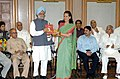 "Manmohan Singh handing over - the report of the first year in office of the UPA Government ""A Caring Government - one year of the UPA Government"" to the Chairperson of the National Advisory Council, Smt. Sonia Gandhi in New Delhi.jpg"