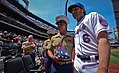 Marine honored at Mets game, Mets outfielder Nick Evans presents American Flag - Fleet Week New York 2011 (5772581199).jpg